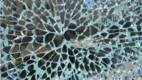 What are the adverse effects of the nickel sulfide in the glass during the tempering process?